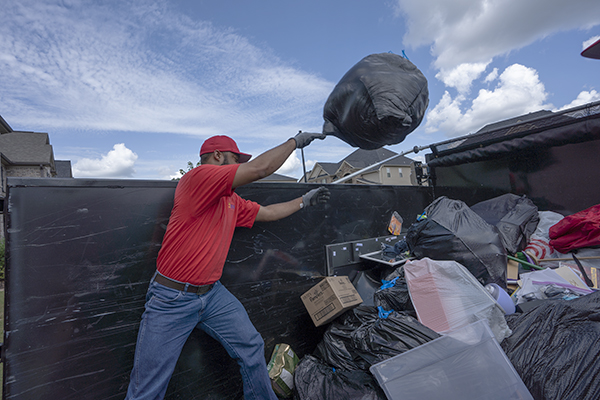 Junk removal worker loading the truck